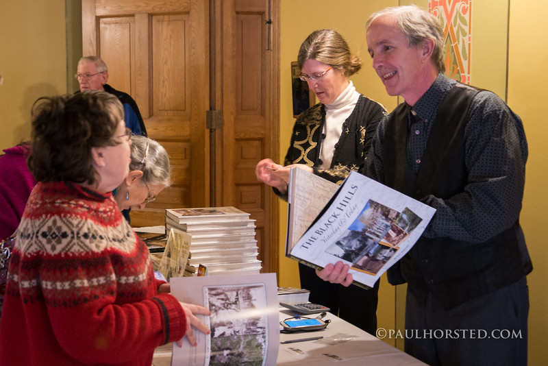 Paul and his wife (and book designer) Camille Riner at book signing at Old Courthouse Museum in Sioux Falls, S.D.