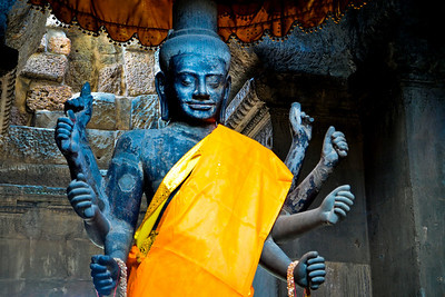 Vishnu.  Suryavarman II was unusual among Khmer kings in making Vishnu rather than Shiva the focus of court religious life. The reasons for this decision are not known. Scholars have long debated whether his association with Vishnu helps explain why Angkor Wat faces west, the cardinal direction with which Vishnu is associated, rather than the common orientation for Khmer temples of east.