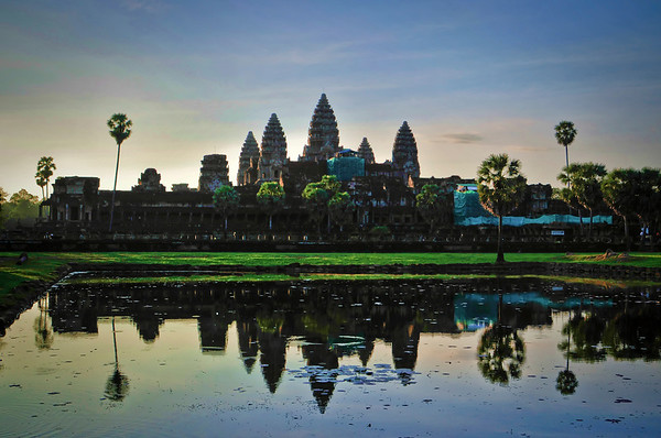 The western side of Angkor Wat in the early morning hours reflected in the moat outside the temple.
