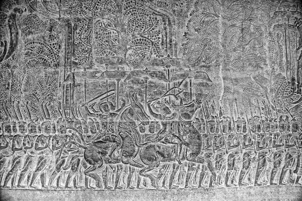 The bas-relief on one of the Angrok Wat walls