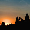 First rays of the morning sun peak through the Angkor Wat wall