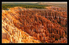 Canyon Rim Sunrise<br /> <br /> The warm light from sunrise falls on the<br /> canyon rim and the many tufa formations below,<br /> enhancing the spectacular oranges in the rocks.<br /> <br /> Bryce Canyon National Park, Utah<br /> <br /> 03-SEP-2004