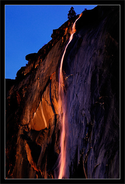 Sunset on Horsetail Fall<br /> <br /> The setting sun illuminates<br /> Horsetail Fall on El Capitan.<br /> <br /> Yosemite National Park, California<br /> <br /> 12-FEB-2011