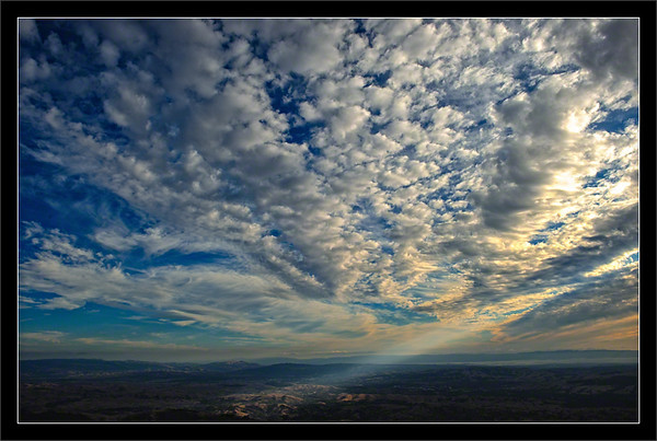 Clouds and Rays Over Amador Valley<br /> <br /> Sunlight breaks through the high clouds<br /> to light the town of Blackhawk-Camino Tassajara<br /> in Amador Valley (near Pleasanton and Dublin).<br /> <br /> Sunol Peak, Mission Peak, the SF Bay waters, and<br /> the Santa Cruz Mountains can be seen in the distance.<br /> <br /> Mount Diablo State Park<br /> Contra Costa County, California<br /> <br /> 01-OCT-2011