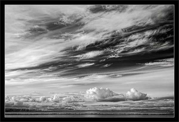 High & Low Clouds Over Bay<br /> <br /> Streaky high clouds and puffy<br /> low clouds fill the sky over<br /> the San Francisco Bay waters.<br /> <br /> SF Bay Area, California<br /> <br /> 20-FEB-2011