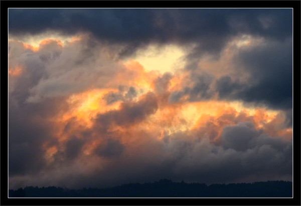 Backlit Clouds Breaking<br /> <br /> The last light of sunset peeks through<br /> low clouds over the Santa Cruz mountains.<br /> <br /> San Francisco Bay Area<br /> California<br /> <br /> 21-NOV-2011
