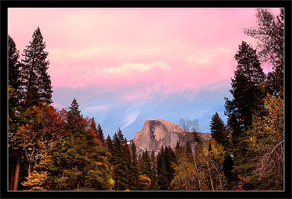Sunset Clouds Above Half Dome<br /> <br /> A pink sunset and fall colors on the<br /> banks of the Merced River frame Half Dome.<br /> <br /> Yosemite Valley<br /> Yosemite National Park, California<br /> <br /> 14-NOV-2010