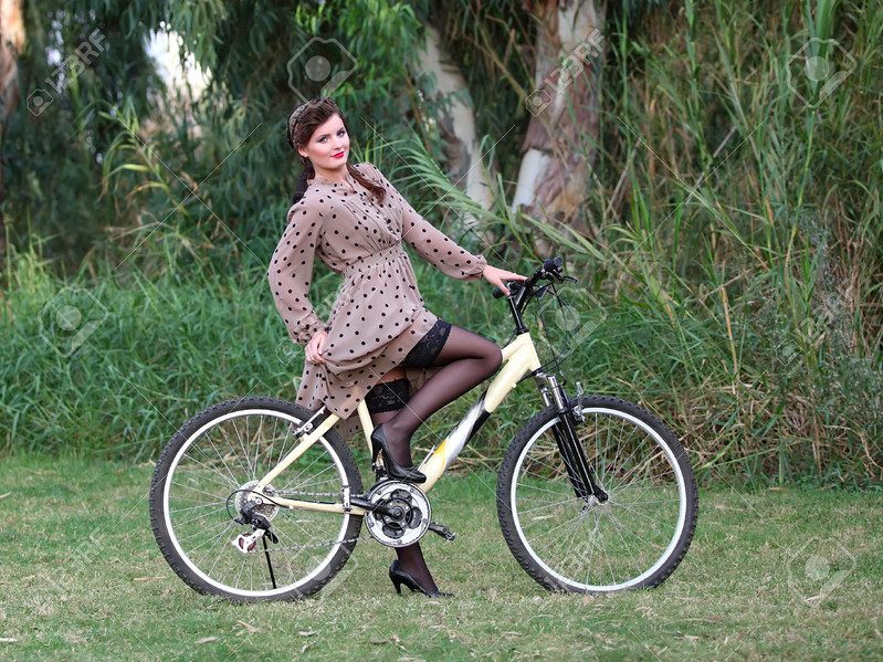 Pin-up girl poising on a bike