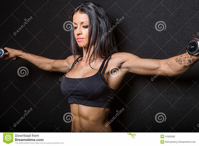 //www.dreamstime.com/stock-photography-female-bodybuilder-flexing-muscles-weights-black-background-image41802082