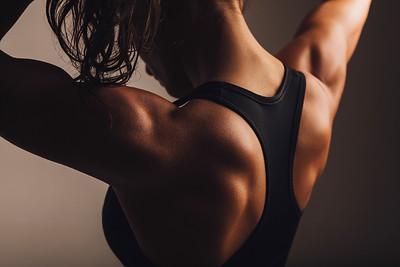 Back of female fitness model