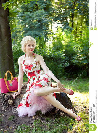 //www.dreamstime.com/stock-image-pin-up-girl-posing-park-image28453851