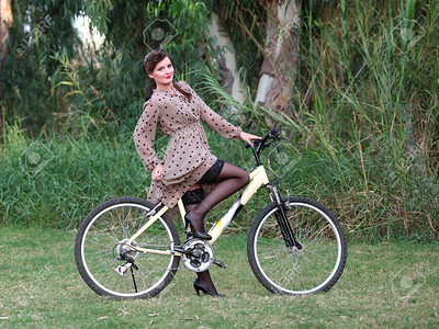 Pin-up girl poising on a bike