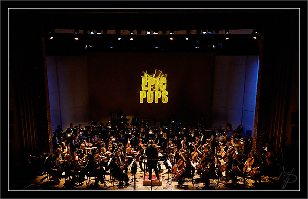 """Mighty Pops<br /> <br /> Christopher Lees, music director, in his surprising<br /> Pops super-cape to conduct the encore, 'Mighty Mouse""""<br /> <br /> F2005 """"Animated Pops"""" Concert<br /> Michigan Pops Orchestra<br /> <br /> 20-NOV-2005"""
