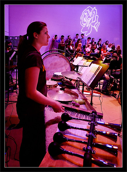 """Ashley McNees<br /> <br /> Ashley, next to the """"American in Paris"""" car horns and<br /> ready with her chimes for """"Beauty and the Beast""""<br /> <br /> Ashley McNees, percussion<br /> Michigan Pops Orchestra<br /> <br /> 01-APR-2007"""