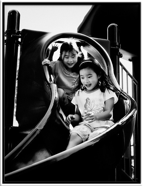 Twins & Slide<br /> <br /> Julianne & Mike's identical twins, Anastasia & Priscilla,<br /> love taking rides together down the big slide.<br /> <br /> (Little brother Evan is not far behind them.)<br /> <br /> Cuesta Park<br /> Mountain View, California<br /> <br /> 12-SEP-2010