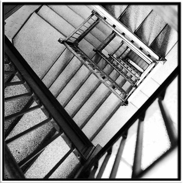 Down Stairs<br /> <br /> Looking through 8 flights of stairs from the top<br /> of Burton Memorial Tower (Bell Tower)<br /> <br /> University of Michigan, Ann Arbor<br /> <br /> 23-JUL-2007