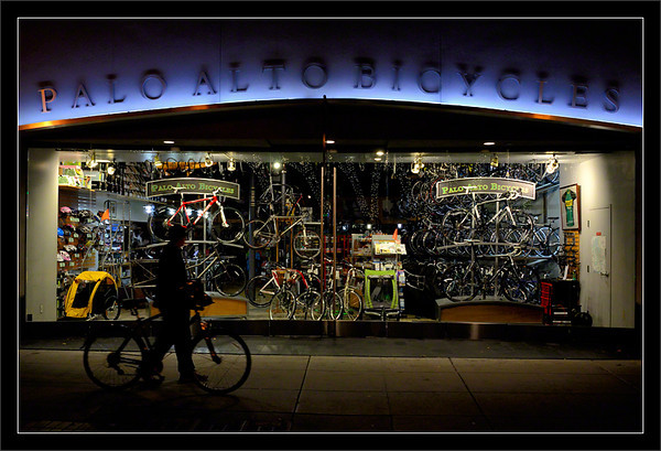Palo Alto Bicycles<br /> <br /> A passing bicyclist can't resist<br /> the alluring window display at night.<br /> <br /> Palo Alto, California<br /> <br /> 27-AUG-2011