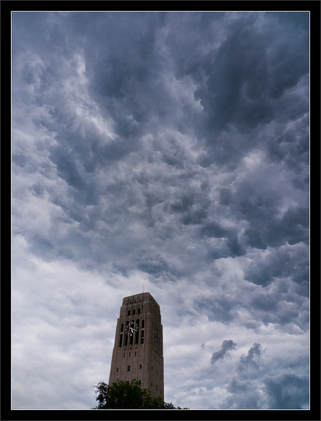 Thunderstorm Clouds Over Burton Memorial Tower<br /> <br /> A large thunderstorm rolls<br /> quickly into Ann Arbor on a<br /> hot and muggy afternoon.<br /> <br /> University of Michigan, Ann Arbor<br /> <br /> 18-JUL-2009
