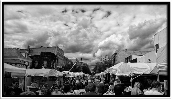 Clouds & People Everywhere<br /> <br /> Afternoon, summer clouds provide<br /> shade (not rain) for the many people<br /> browsing art booths on Main Street.<br /> <br /> Ann Arbor Art Fairs<br /> Ann Arbor, Michigan<br /> <br /> 18-JUL-2009