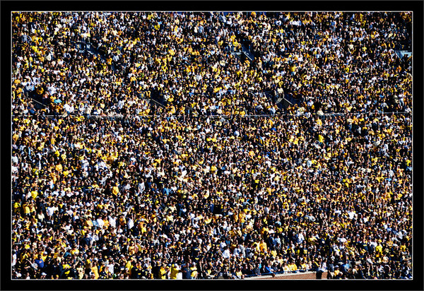 Homecoming: 109,750<br /> <br /> Partial view into the east seating sections<br /> <br /> Michigan wolverine fans gather<br /> for homecoming at the Big House.<br /> <br /> The recorded attendance was 109,750.<br /> <br /> Michigan Stadium<br /> University of Michigan, Ann Arbor<br /> <br /> 04-OCT-2008