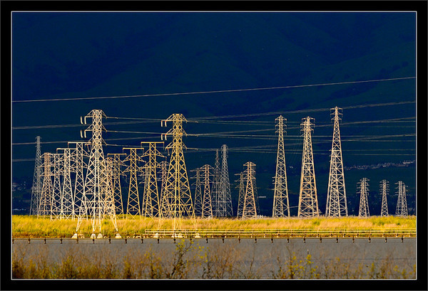 Power Grid Sunset<br /> <br /> Power transmission towers and lines<br /> carry electricity across the waters<br /> in the South Bay (San Jose) region.<br /> <br /> These lines distribute over 4,000<br /> megawatts of eletricity to the Bay Area.<br /> <br /> San Francisco Bay Area, California<br /> <br /> 23-APR-2011