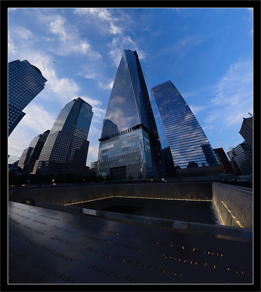 "One World Trade Center: Reflection & Rebuild<br /> <br /> The northern reflecting pool (one of two) <br /> of the ""Reflecting Absence"" memorial is located<br /> in the original footprint of WTC 1 ""Tower One.""<br /> <br /> The rebuilt One World Trade Center (Freedom Tower)<br /> rises 1776 feet behind the memorial plaza.<br /> <br /> National September 11 Memorial Plaza<br /> New York, New York<br /> <br /> 25-AUG-2013"