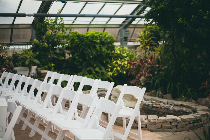A summer wedding in a tropical greenhouse.