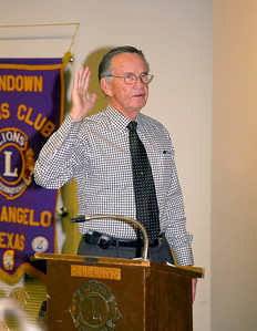 Sundown Lions Club inducted new members Thursday, Jan 23, 2009.  Pictured is former Lion International President Ebb Grindstaff administering the oath.
