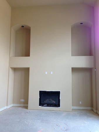 View of the Family Room wall/fireplace.  We hope to have stone installed floor to ceiling