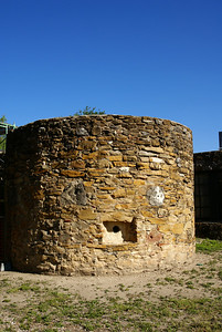 The round room is known as the Bastion.  It served as fortification with ports to allow for cannons and rifles to be fired from.