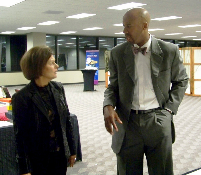 Barbara Gentry, Senior Vice President, Office of Community Affairs of USAA talks with San Antonio Spurs Bruce Bowen.