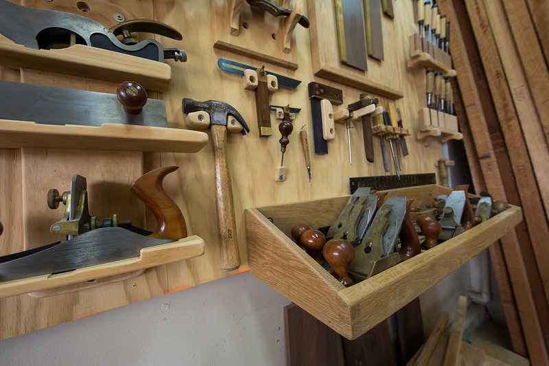 All my most often-used hand tools hang behind me as I stand at the bench. I originally considered facing my bench toward the wall and having my tools hang above it, but I don't like having to lean over the bench to retrieve a tool.