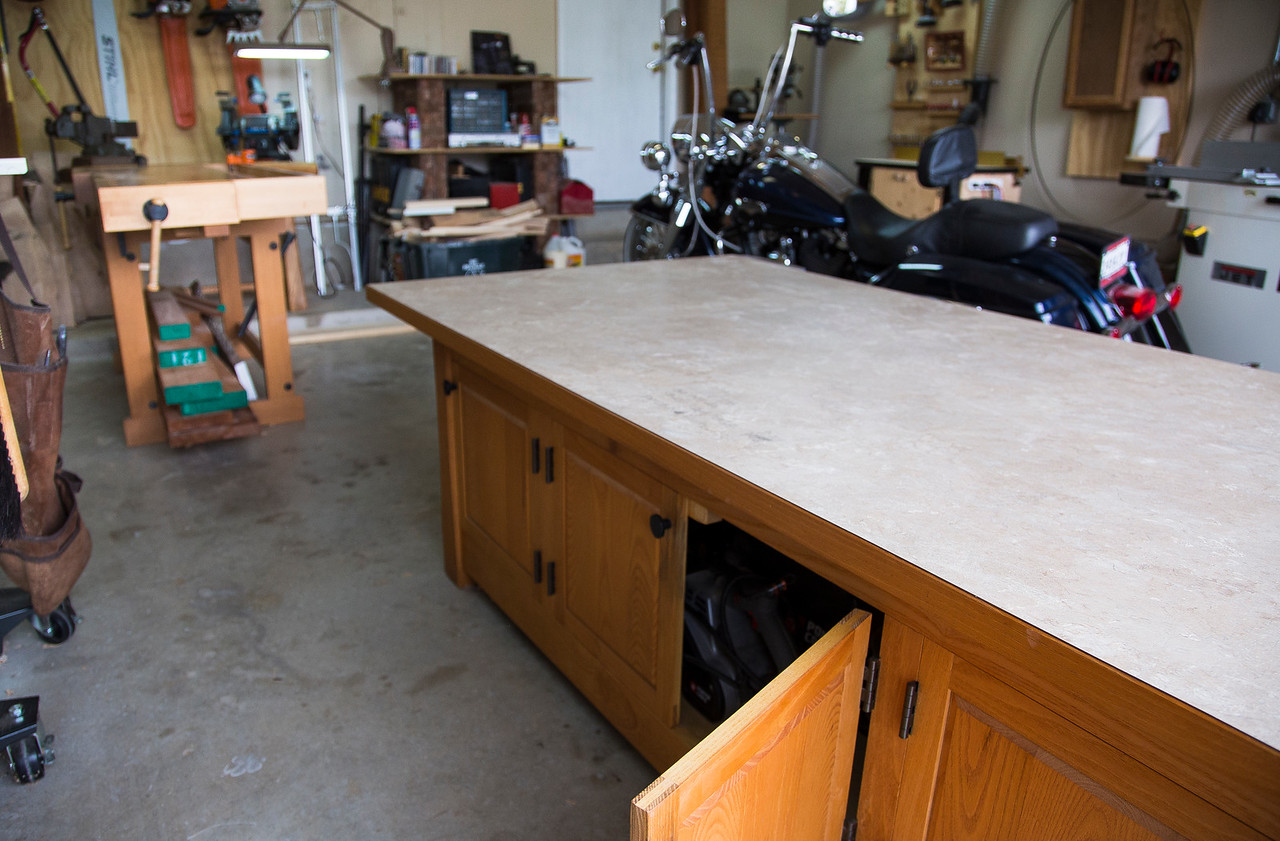 "My ""assembly table"", featuring a flat laminated top for glue-ups and finishing, as well as a massive amount of storage space for all hardware and hand power tools."