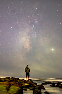 Self portrait among some tidepools at Windansea Beach with the Milky Way in the background.
