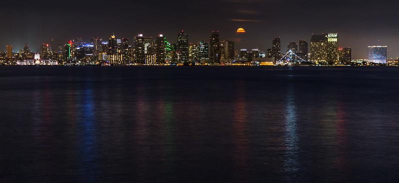 Orange-colored Bull Moon rises among San Diego skyline. Take 2.