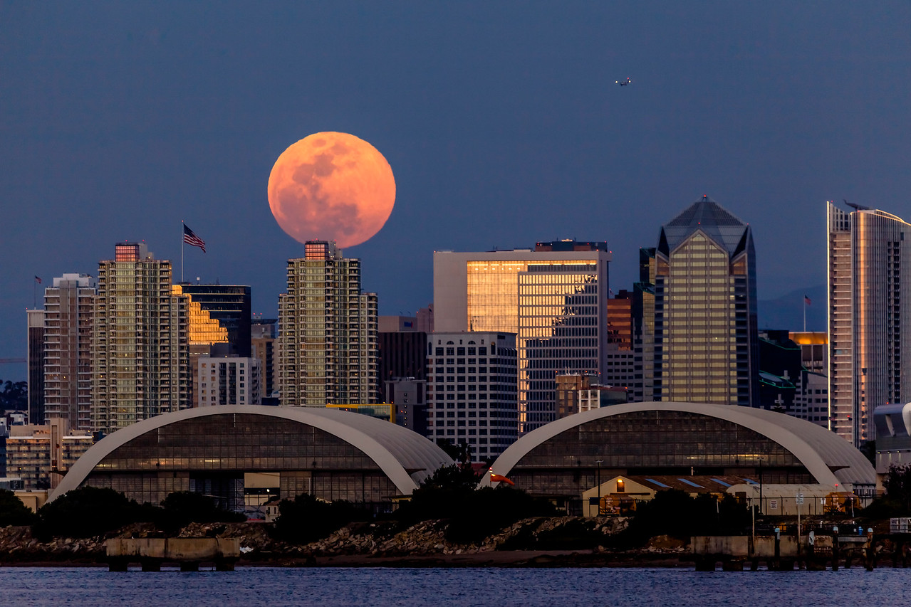 Full Moon Rises Over the San Diego City Skyline and Hangars at Naval Air Station North Island
