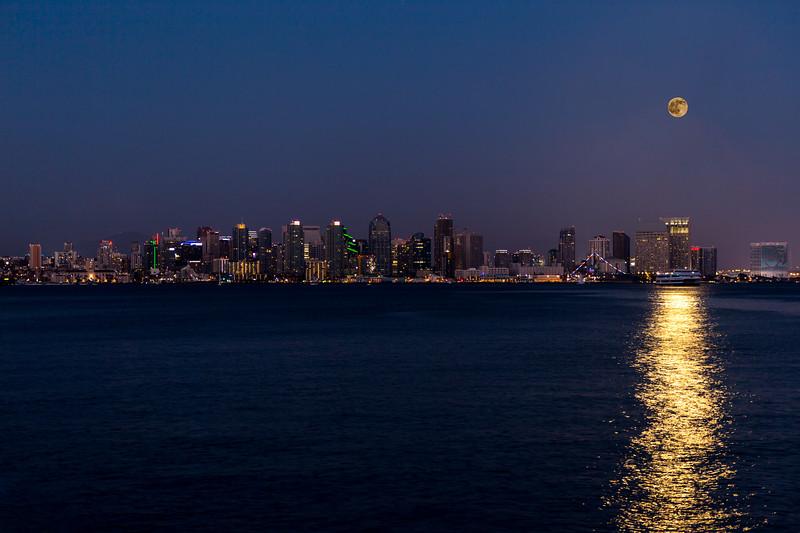 Full buck moon over San Diego city skyline