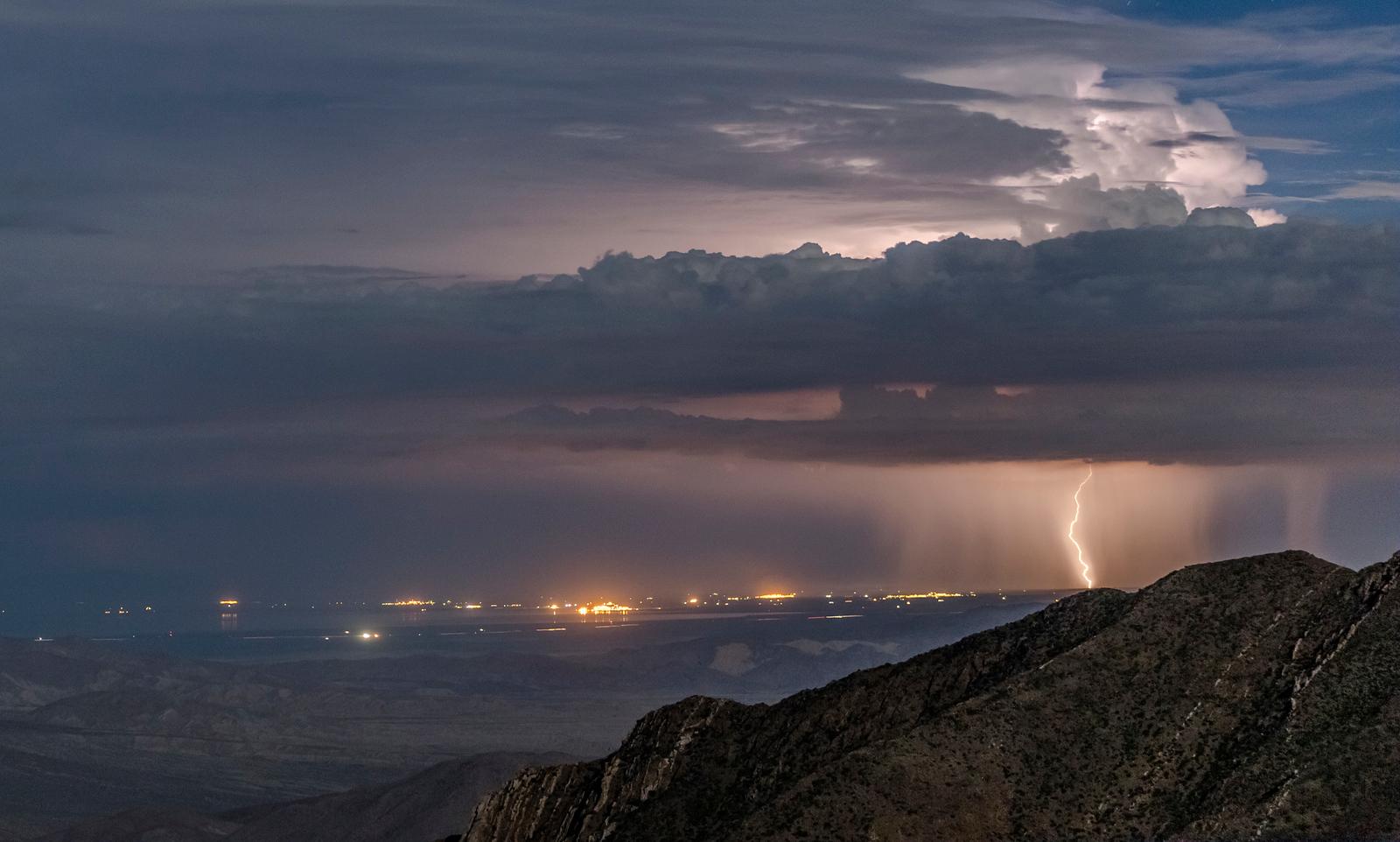 Lightning bolt and rain over Brawley and/or El Centro, California.