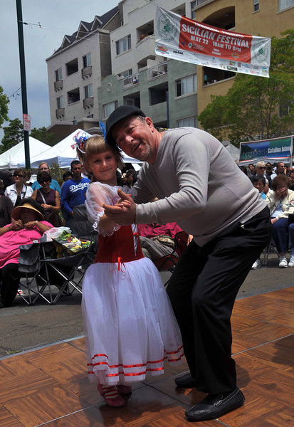 Little Girl Dancing Under the Sicilian Festival Sign, Sicilian Festival 2011