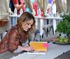 Giada Signing Fan's Book