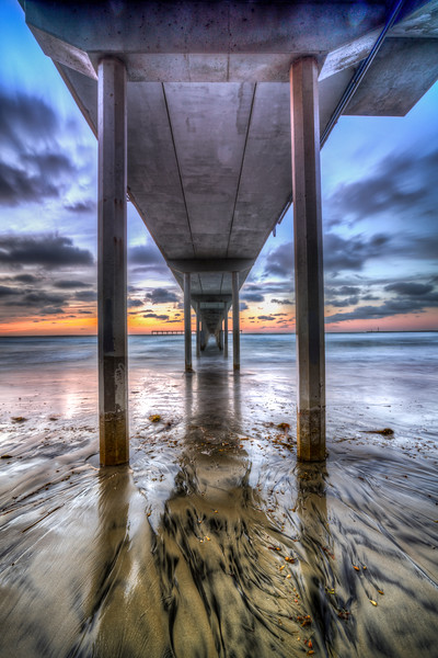 9 shot HDR LE before the sunset explosion at Ocean Beach, San Diego.<br /> These black streaks are mineral in the soil (sand) called Alluvial Patterns.<br /> 🔸As the camera was the camera was crunching away at the 9 shots, the water came all the way to the seawall. I jumped up an hung from the wall to keep my shoes dry. Seemed like it took 60 seconds to subside<br /> 🔸 At sunset under the OB Pier<br /> 🔸 9 shot HDR, Photomatix<br /> 12▫4▫15