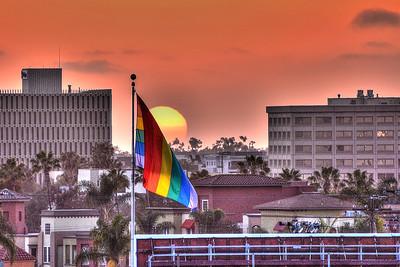 Pride Flag Over Hillcrest at Sunset