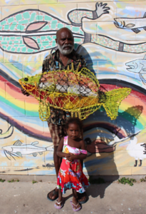 Artist Sid Bruce Short Joe with a ghost-net Fish and a small relative