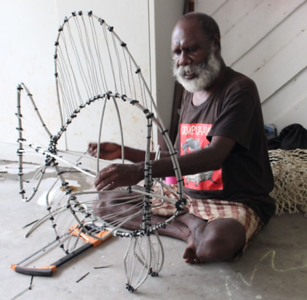 Artist Sid Bruce Short Joe creating a ghost-net sculpture
