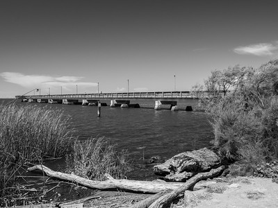 Foreground: Fishing Pier & Sacramento-San Joaquin River Delta. In the distance: Windmills in Rio Vista, CA (left)  Antioch/Oakley Regional Shoreline. Antioch, CA, USA