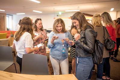 Alumni play a Chico State themed bingo game at Chico State's Alumni Day at Salesforce West on Thursday, May 10, 2018 in San Francisco, Calif. (Jessica Bartlett /University Photographer/CSU Chico)