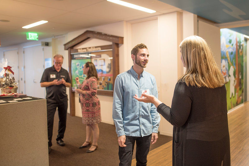 Ian Twamley (left) enjoys a conversation with Shari Anderson (right) at Chico State's Alumni Day at Salesforce West on Thursday, May 10, 2018 in San Francisco, Calif. (Jessica Bartlett /University Photographer/CSU Chico)