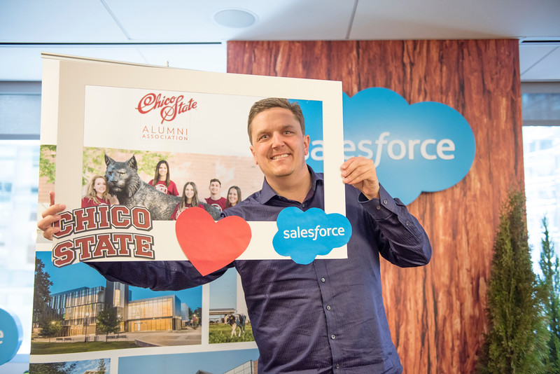 Alumnus Jonathan Shore takes a photo at the photo booth at Chico State's Alumni Day at Salesforce West on Thursday, May 10, 2018 in San Francisco, Calif. (Jessica Bartlett /University Photographer/CSU Chico)