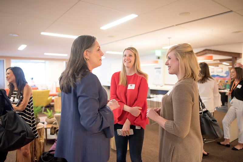 Alumnus Ashley Snyder (center) enjoys a conversation at Chico State's Alumni Day at Salesforce West on Thursday, May 10, 2018 in San Francisco, Calif. (Jessica Bartlett /University Photographer/CSU Chico)