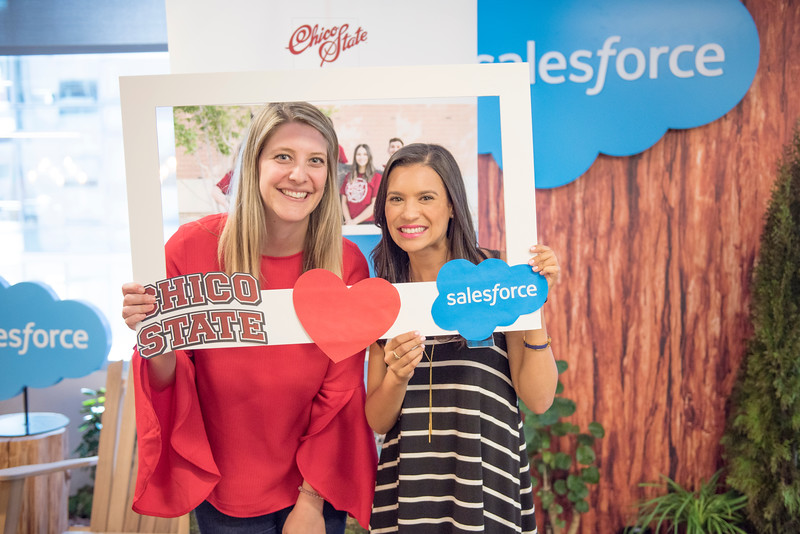Alumni Ashley Snyder (left) and Jenell Sierra (right) take a photo together at the photo booth at Chico State's Alumni Day at Salesforce West on Thursday, May 10, 2018 in San Francisco, Calif. (Jessica Bartlett /University Photographer/CSU Chico)